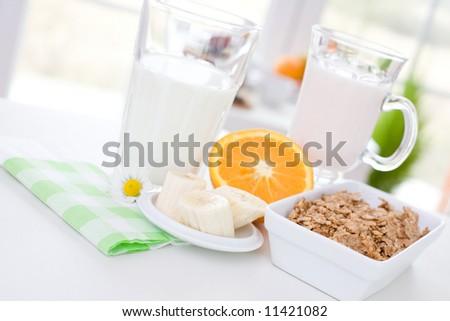 Delicious breakfast / cereal, yoghurt, orange, banana - stock photo