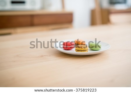Delicious breakfast some macarons in a dish - stock photo