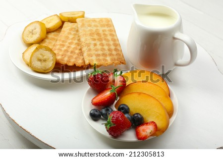 Delicious breakfast with milk, cookies and fruits - stock photo