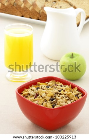 delicious breakfast with whole grain bread,fresh green apple and a healthy bowl of muesli cereal. - stock photo