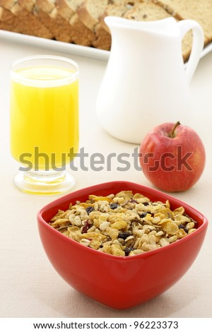 delicious breakfast with whole grain bread,fresh red apple and a healthy bowl of muesli cereal. - stock photo