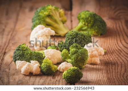 Delicious broccoli and cauliflower has a wooden rustic table - stock photo