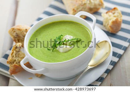 Delicious broccoli cream soup with rye bread . International cuisine meal. - stock photo