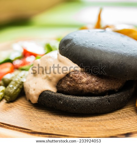 Delicious burger with beef, tomato, lettuce and fries. selective focus - stock photo