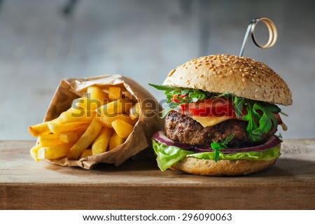 Delicious burgers with beef, tomato, cheese and lettuce - stock photo