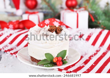 Delicious cake on saucer with holly and berry on Christmas decoration background - stock photo