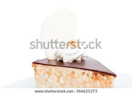 Delicious cake with chocolate curl and hazelnut. Macro. Photo can be used as a whole background. - stock photo