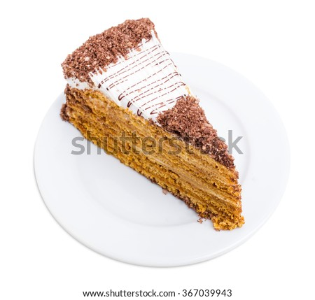 Delicious cake with grated chocolate and walnuts. Isolated on a white background. - stock photo