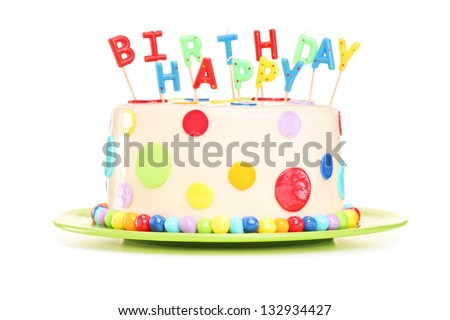 Delicious cake with happy birthday candles, isolated on white background - stock photo