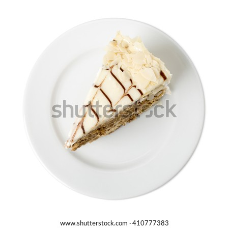 Delicious cake with nuts and white chocolate. Isolated on a white background. - stock photo