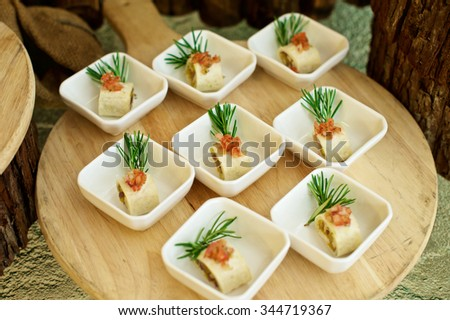 Delicious Canap���©s starters on plate in restaurant - stock photo