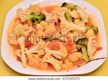Delicious cauliflower with tomato dish - stock photo