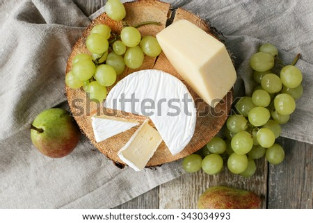 Delicious cheese on the table - stock photo