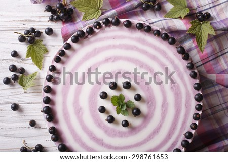 Delicious cheesecake striped black currant close up on the table. horizontal top view - stock photo