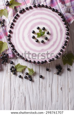 Delicious cheesecake striped black currant on the table. vertical top view - stock photo