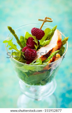 Delicious chicken and raspberry salad for holiday - stock photo