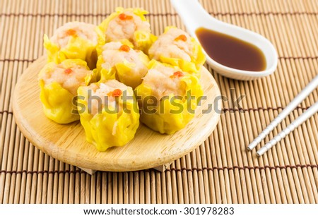 Delicious chinese dim sum on wooden plate  - stock photo