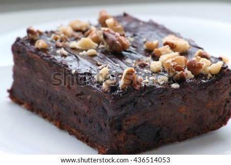 Delicious chocolate brownie. Homemade chocolate cakes on top with walnuts. Shallow depth of field. - stock photo
