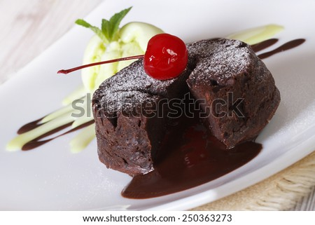 Delicious chocolate cake fondant with cherry closeup on a plate. horizontal  - stock photo