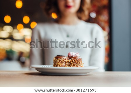 Delicious chocolate cake in shape of heart on wooden table in a cafe - stock photo