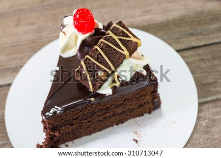 Delicious chocolate cake on wooden light background - stock photo