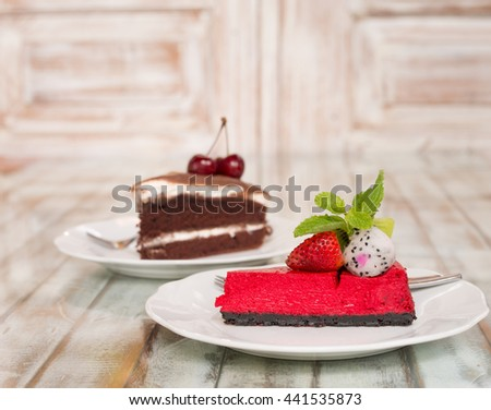 delicious  Chocolate cake slice on white plate mint strawberry and dark Chocolate cake slice on white plate mint cherry - stock photo