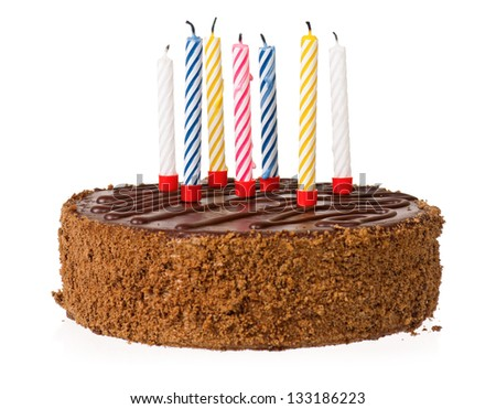 Delicious chocolate cake with candles, isolated on white background - stock photo