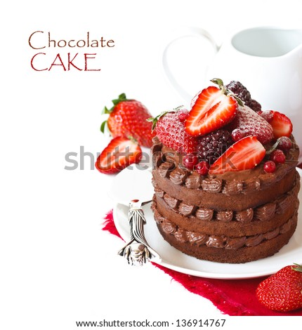 Delicious chocolate cake with cream and berries on a white background. - stock photo