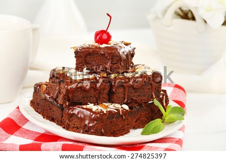 Delicious chocolate cakes on plate on table close-up - stock photo