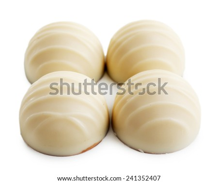 Delicious chocolate candies isolated on white - stock photo
