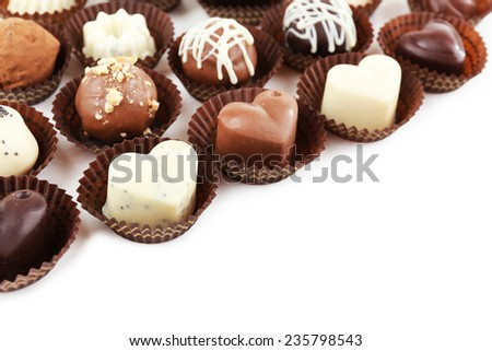 Delicious chocolate candies on white background - stock photo