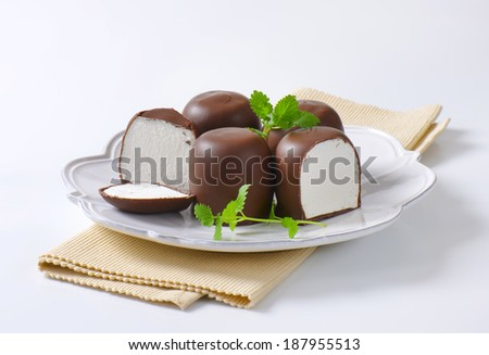 Delicious chocolate candies with white filling - stock photo
