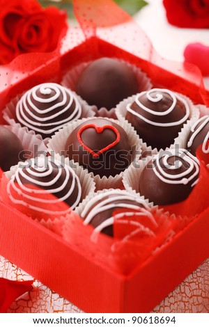 Delicious chocolate pralines  in red box for Valentine's Day - stock photo