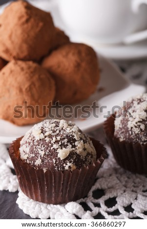 Delicious chocolate truffle candies macro on a lace tablecloth. vertical - stock photo