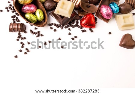 Delicious chocolates and easter egg on a white background.  - stock photo