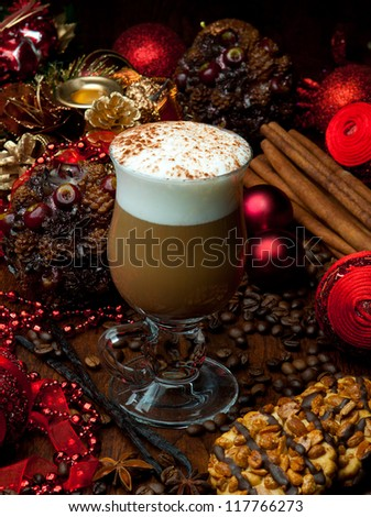 Delicious christmas coffee with spices and decoration - stock photo