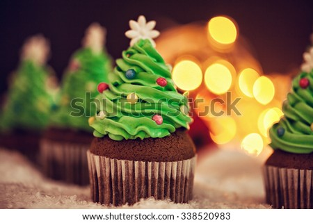 Delicious Christmas Dessert. Christmas Tree Cupcakes - stock photo