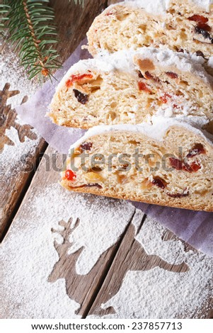 Delicious Christmas fruit bread Stollen closeup on the table. vertical, rustic style  - stock photo