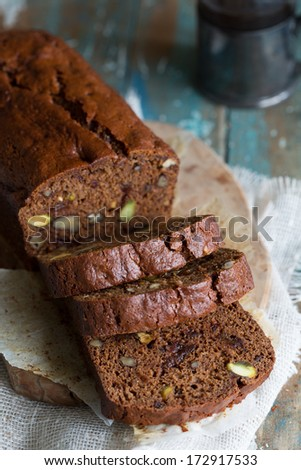 Delicious coffee and date cake with pistachio and cranberries - stock photo