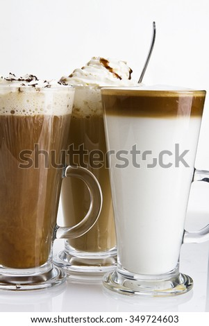 delicious coffee cocktails on white background. different coffee types in cool glasses - stock photo