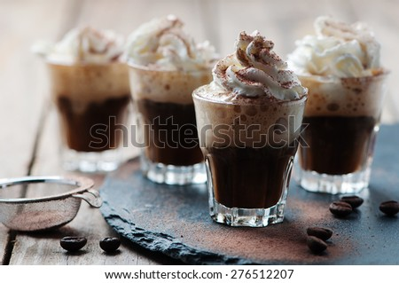 Delicious coffee with crean and cocoa, selective focus - stock photo