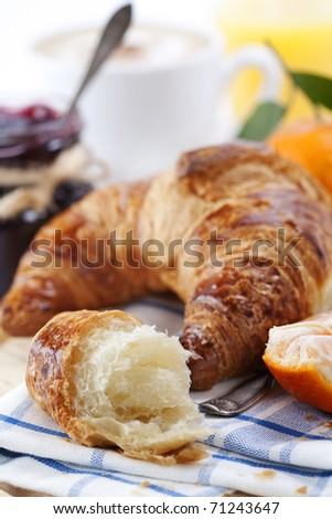 Delicious continental breakfast with coffee, jam and croissant - stock photo