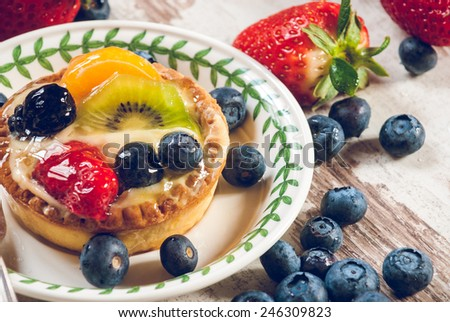 Delicious cookie made shortcrust pastry with fresh fruit, strawberries and blueberries. - stock photo