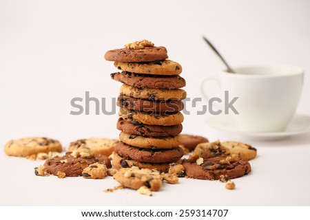 delicious cookies with chocolate on a white table - stock photo
