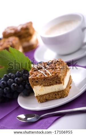 Delicious cream cake and coffee. - stock photo