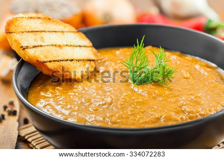 Delicious cream soup made of lentil and vegetables on table, close-up - stock photo