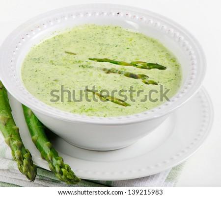 Delicious creamy asparagus soup - stock photo