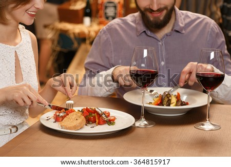 Delicious. Cropped shot of a couple eating at the restaurant  - stock photo