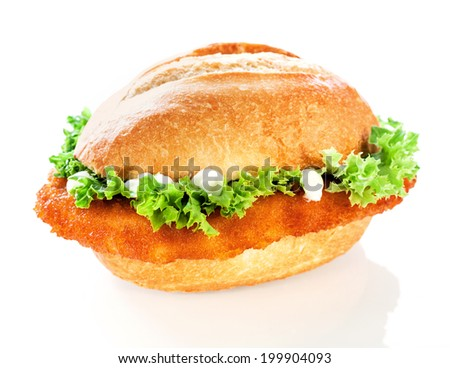 Delicious crusty fish burger or roll with a golden fried crumbed fish fillet and crinkly lettuce topped with mayo on a white background - stock photo