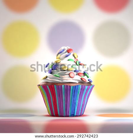 Delicious cupcake with smarties on a whipped cream. Colored disks background. - stock photo